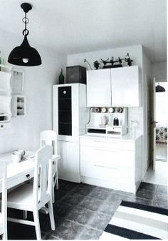 New Style Flat: Tarja re-designed her dream home in Espoo, Finland. Simple modern style was replaced with old whole-wood furniture with plenty of white and some black accents. Photo credits to Krista Keltanen. Copied from Koti ja Keittiö 5/2014. See http://www.pinterest.com/pin/557742735075098960/ for the living room.
