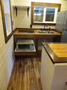 Pull out drawers in the kitchen of the Robin's Nest tiny house! see more at brevardtinyhouse.com