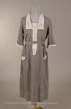 1920-1923 Maternity Dress:  checked cotton trimmed with lawn and embroidered embellishment.