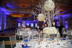 tall silver centerpieces for winter wonderland wedding decor - Loews Portofino Bay Wedding - Orlando Wedding - Photo: Victoria Angela Photography - Orange Blossom Bride