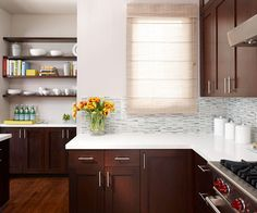 Warm Contemporary Kitchens. A contemporary kitchen is well-chosen colors, materials, and personal objects take the chill out of modern work spaces. Pictured: Storage with Style. Dark-stained cherry cabinets seem traditional, but clean-lined Shaker-style doors and simple hardware add modern flair. A backsplash of glass tile in shades of gray complements the white quartz countertops.