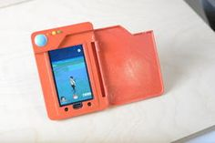Stylish DIY Pokedex cover helps with Pokemon Go battery woes     - CNET  Enlarge Image                                              Nick Poole/Spark Fun                                          As any seasoned Pokemon trainer will tell you Pokemon Go has quite a habit of draining your phones battery life.  This means that you either have to lug around an unwieldy portable power bank or simply go home and live in a world without Pokemon. As if anyone would want that.  However thanks to one…