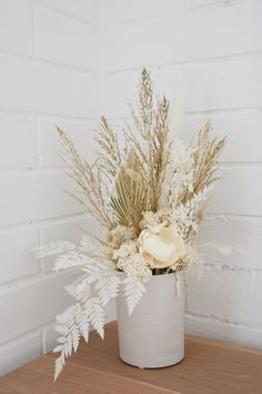 Were in love with our latest dried and preserved flower arrangement - white beauty - this delicate floral arrangement fe Flower Pot Design, Floral Design, Floral Wedding, Wedding Flowers, Modern Flower Arrangements, Artificial Flower Arrangements, Dry Plants, Order Flowers, Dry Flowers