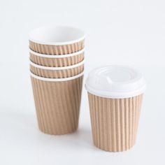 Plain and simple kraft cups are a charming (and convenient) way to serve cocoa, coffee, or cider. Pack of 10, 8 oz. cups with lids