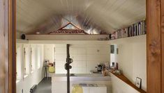 This garage was converted into a minimalist studio by Seattle-based SHED Architecture & Design. Right away you will notice the simple kitchen, built Garage To Living Space, Garage Guest House, Garage Bedroom, Car Garage, Backyard Cottage, Cottage House Plans, Cottage Homes, Shed To Tiny House, Tiny House Loft
