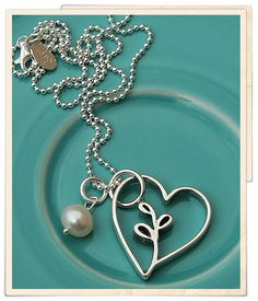 """you grew in my heart"" necklace from the Vintage Pearl.  Beautiful piece for adoptive or step-parents."