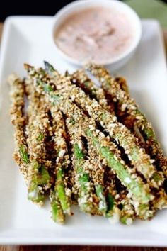 Crunchy baked asparagus fries with lemon herb sriracha dip