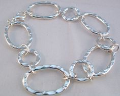 A very pretty bracelet with all circle links that were hammered for added texture. Fits a size wrist. Made from non-tarnish silver. Tarnished Silver, Texture, Bracelets, Check, Handmade, Jewelry, Surface Finish, Hand Made, Jewlery
