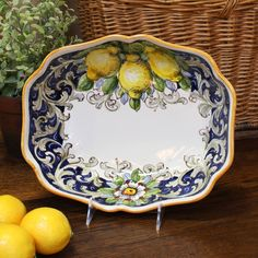 "Description An indispensable ceramic serving bowl handpainted with cheerful lemons. This serving bowl is rectangular with a rounded, gently scalloped shape. This new ""Limoni"" pattern features lemons o"