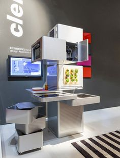 ECOOKING is a complete vertical kitchen which interprets and solves the problems of contemporary small space living. Powered by the energy produced by solar panels, on one side is placed a small vertical garden for the cultivation of aromatic plants for daily use. The water from the sink is filtered and reused in the dishwasher; then undergoes a second filtering and is used to water the plants in the vertical greenhouse.