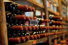 bottles of red wine in rack Stock Photo