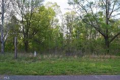 3.71 acre lot with road frontage.  Great place to build a new home or put a mobile home.  Home that was on the property burned and has a concrete drive going to the home site.  Some of concrete foundation of the old home is still at the site.  Septic tank on the property.  Power pole in place along with access to county water. Gorgeous valley with a mountain view from the build site.