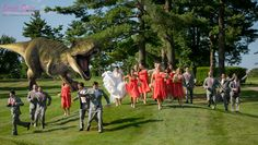 I love this! I've taken so many creative wedding photos for brides and grooms but a T-Rex chasing the bridal party like something out of Jurassic World takes the (wedding) cake! | Lynda Berry Photography