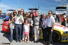 The Labonte family and friends gather at Talladega Superspeedway on the occasion of Terry's final NASCAR race, October 2014. From left to right: Kristy Labonte Garrett, Yvette Comstock, Matt Garrett, Harper Garrett (on Matt's shoulders), Josh Comstock, Heidi Stoddard, Sydney Stoddard, Kim Labonte, Texas Terry, Lexi Stoddard, Frank Stoddard. Josh Comstock is the CEO of car sponsor C&J Energy Services and the Stoddards are the car owners. (Photo by Elmer Kappell.)