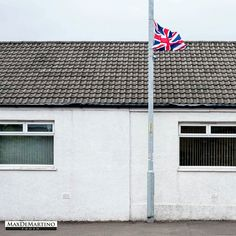 An English flag at the wind in Harthill, Scotland, during a loyalist party meeting.