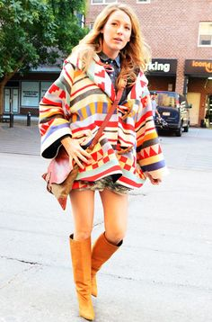 The radiant mom-to-be showed off her miles-long legs in a Sam and Lavi miniskirt, colorful Lindsey Thornburg poncho coat, and knee-high brown leather boots.