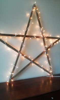 Lighted star out of tobacco sticks from my grandparents' farm. Gonna put orange lights on it for fall :)