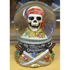 Disneyland Pirates of the Caribbean Skull and Coins snow globe. He and the zombie are in cahoots.