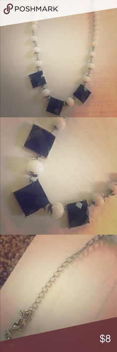 Black, White and Silver Statement Necklace Black white and silver Statement necklace in perfect condition. No flaws or signs of wear! All purchases and bundles also come with same day shipping and a surprise gift. Jewelry Necklaces