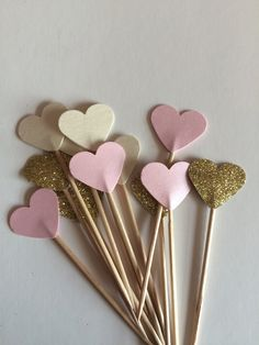 12 super pretty mixed colour cupcake toppers, you will receive 4 shimmery pink toppers, 4 shimmering Ivory toppers and 4 uber sparkly gold toppers