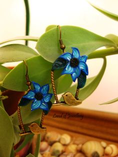 Polymer clay earrings. Made with antiqued brass pendants and hand-crafted polymer clay flowers.