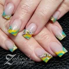 Seafoam, yellow, and rhinestone waves really make these nails by @zi_nails stand out!