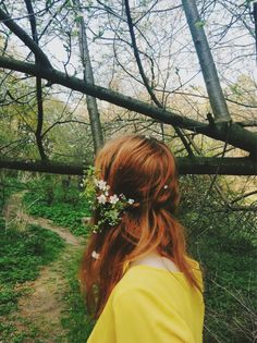 redhead, flowers in hair, trail ahead, in the woods, is she alone? the color of her cardigan