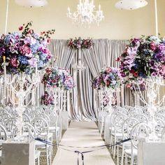 Photographer: Melanie Duerkopp, Via Amy Burke Designs; Luxury silver wedding ceremony with elegant purple floral design;