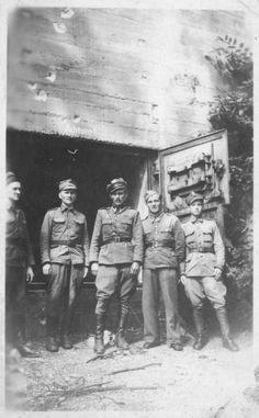 Shmuel (Samuel) (pictured center) and other Polish soldiers pose in front of the Wolf's Lair (Wolfsschanze), Hitler's wartime bunker in northern Poland.