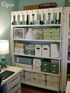 great use of storage boxes - all tied together by color for a great look