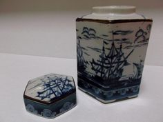 Here we have a vintage, ginger/tea/coffee jar, made in Japan for Andrea of Sadek. Jar is six sided with a grayish background showing off blue sailing    offered by #rubylane shop Saltymaggie's Treasures