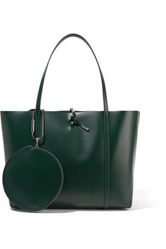 KARA's tote is meticulously crafted from vegetable-tanned emerald leather that's designed to wear beautifully over time. Finished with the label's signature tie fastening, this style has an open, unlined interior with plenty of room for daily essentials. Use the internal pocket and detachable pouch to hold your cards, keys or cell phone.