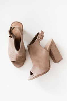 """Taupe heels with a soft faux suede texture. Peep toe and an adjustable ankle strap. Lightly padded insole with a rubber sole. Heel height measures approx. 4"""".  All man made material True to US size Imported"""