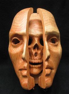 Mask carved in wood, hung on hinges & opening to the skull inside. Carved by the 3D artist & designer Anthony Santella.