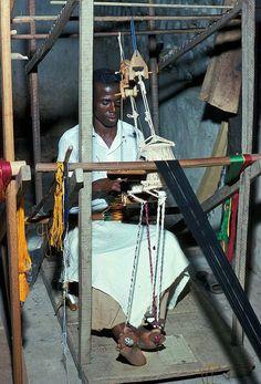 Africa | Man weaving strips of Kente cloth | Via Earth Metropolis African Art