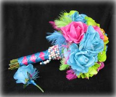 Real Touch Rainbow roses. Vibrant colored roses with feathers and pearls make this a unique one of a kind wedding bouquet & boutonniere set!
