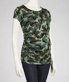 Soft and stretchy, this maternity top is perfect for bringing out that mom-to-be glow, while leaving a growing baby bump plenty of breathing room. The flattering side shirring, contrast piping and on-trend camo pattern ensure this casual piece looks polished during any of the pregnancy months.