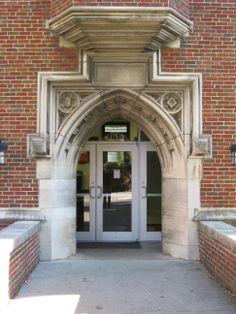 Earth & Planetary Sciences Building, 1928, North Main Entrance.  Quatrefoil Tracery in Arch Spandrels.
