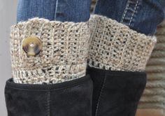 @Melissa Jozwiak  Something with a button would be real cute. Crochet Boot Cuffs - Oatmeal