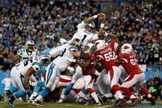 Cam Newton #1 of the Carolina Panthers scores a touchdown in the second quarter against the Arizona Cardinals during the NFC Championship Game at Bank of America Stadium on January 24, 2016 in Charlotte, North Carolina. (Jan. 23, 2016 - Source: Streeter Lecka/Getty Images North America)