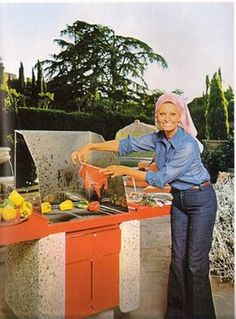 """Sophia Loren's 1971 """"Cucina con Amore"""" cookbook is not so much about the recipes but a lot more about bizarre photos of Ms. Loren hiding amongst Italian delicacies."""
