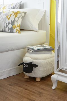 Add the sheep storage ottoman to your living space for a delightful and practical accent piece. It can be used for storage, as a footrest or an impromptu seat for unexpected guests. Wooden legs offer sturdy base.