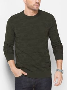 A camouflage pattern transforms this classic crewneck sweater. Partner it with chinos or denim for a stylish take on casualwear.