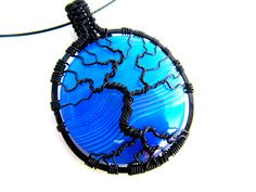 "Tree of Life Pendant  - Bright Blue and Purple Striped Agate Cabochon with Black Wire - 1.75"" x 2.25"" - Cord Included by CarrieEastwood on Etsy https://www.etsy.com/listing/213196192/tree-of-life-pendant-bright-blue-and"