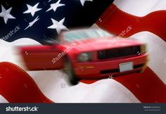 blur red car on usa flag used as background