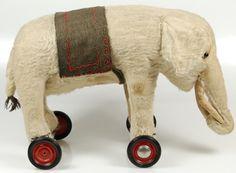 Vintage elephant on wheels