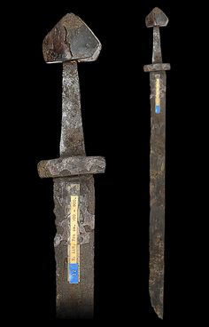 "myArmoury.com A Rare Viking Sword Of Petersen Type C and Wheeler Type II, 9th/early 10th century, probably Norwegian  In excavated condition, with broad fullered single-edged blade, hilt comprising thick ovoidal cross-piece, flat tapering tang, and pommel of tea-cosy form   Overall length: 83.8 cm (33""); Blade length: 68 cm (26.8"")"