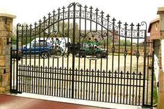 Such an awesome driveway gate design