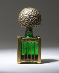 """Giardini,"" a perfume bottle for Babani, circa 1920, in green glass with gilded and enameled detail. Ht. 4 3/8 in (11 cm) #BookofLostFragrances #Suspense #Novel"