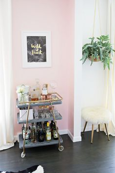 25 Pastel Accent Walls that Will Inspire You to Paint | Pink accent wall + cute bar cart and fur stool